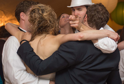 Friends arm in arm at the best wedding ever!